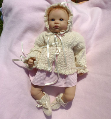 baby's hand knitted clothes